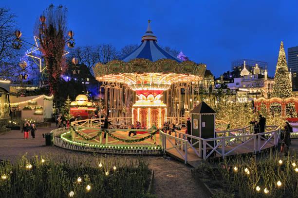 Carousel and christmas illumination in Tivoli Gardens in Copenhagen, Denmark stock photo