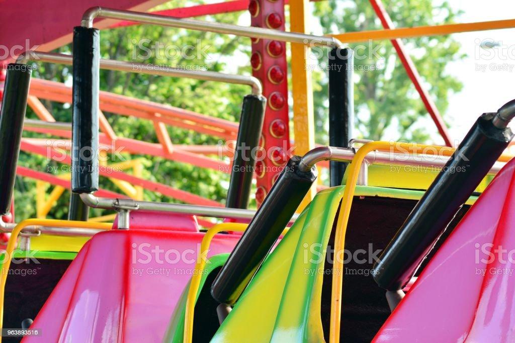 Carousel at amusement park. - Royalty-free Bright Stock Photo