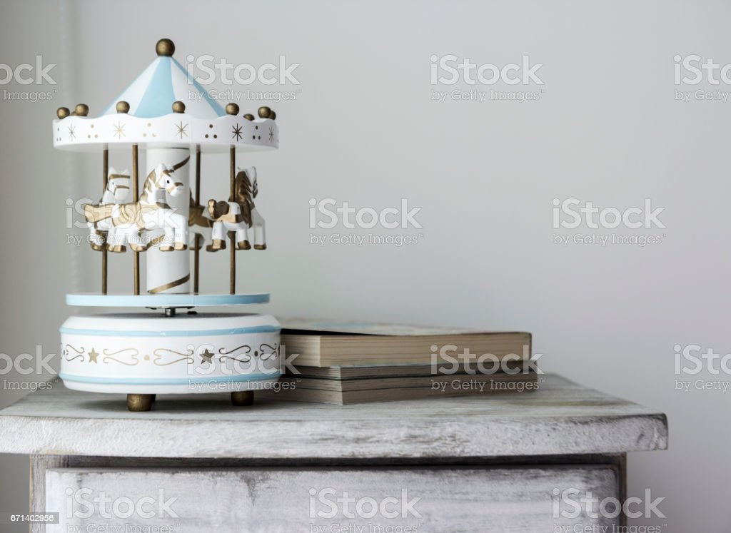 Carousel horse on vintage cabinet stock photo