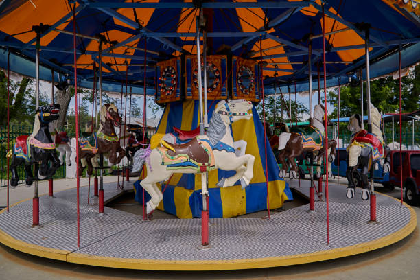 Carousel horses on a Merry Go Round stock photo