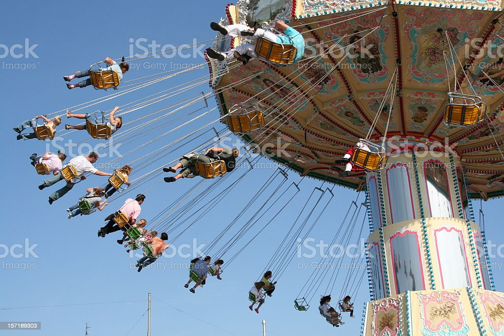 Carousel in a amusement park stock photo