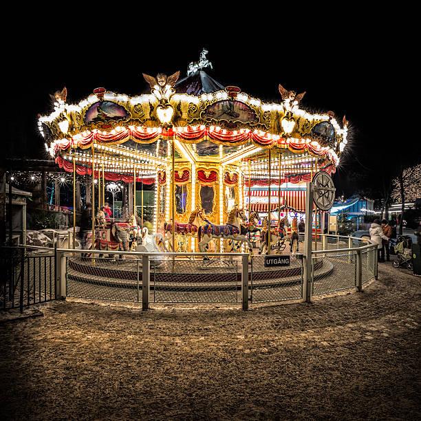 carousel in a winter evening. - liseberg bildbanksfoton och bilder
