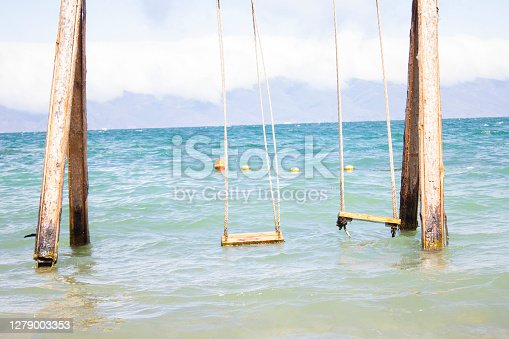 wooden carousel in the blue sea background