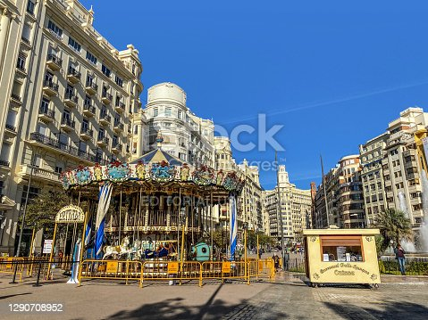 Valencia, Spain - November 30, 2020: Old-fashioned carousel in the Town Hall plaza in the city downtown. This is mounted here to amuse children during the Christmas and New Year period