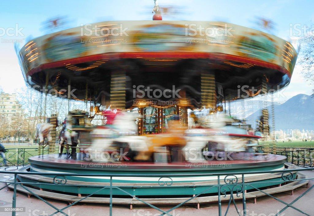Carousel merry-go-round while rounding stock photo