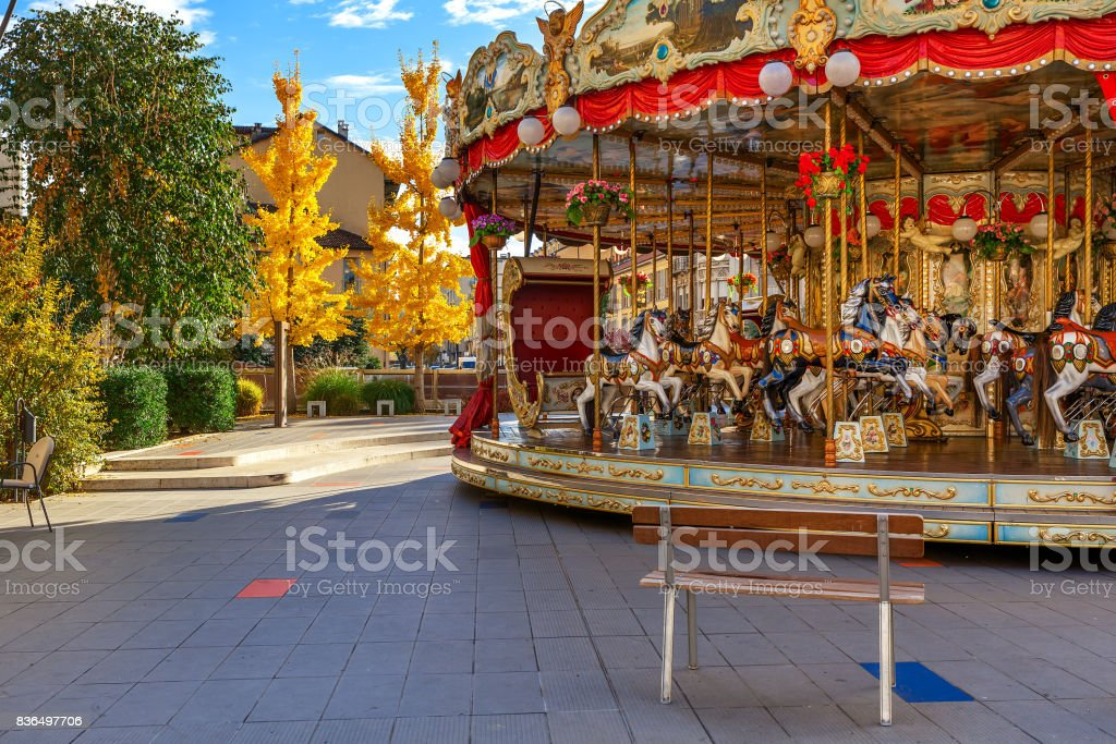 Carousel on town square in Alba. stock photo