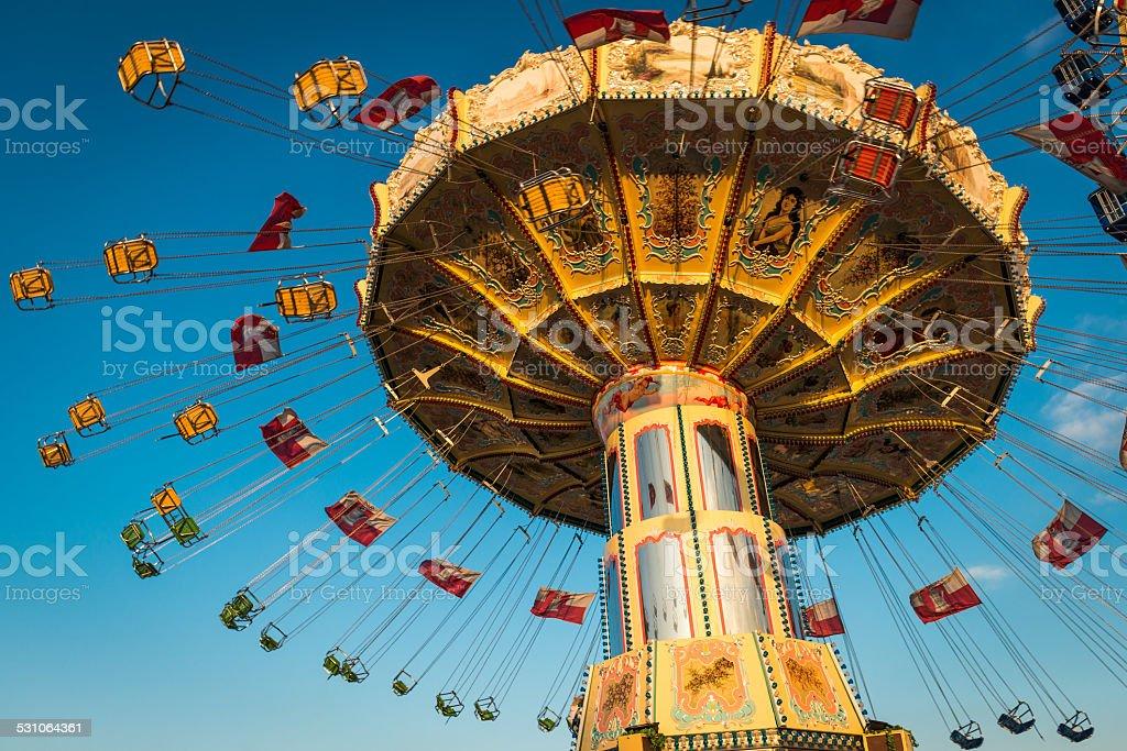 Carousel spinning stock photo