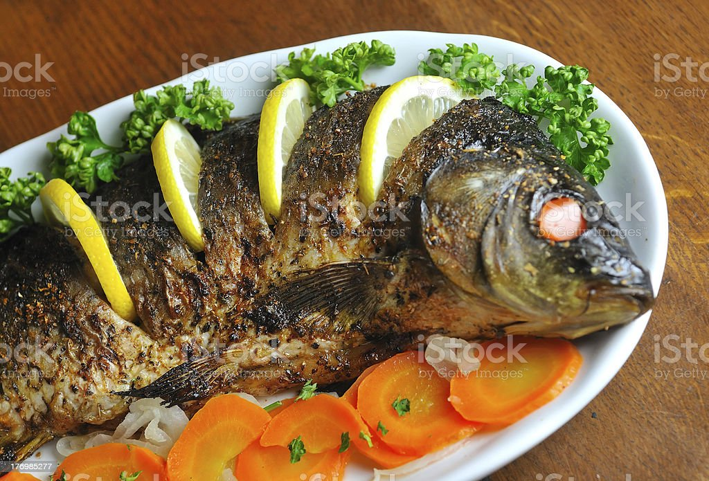 Carp baked with vegetables royalty-free stock photo