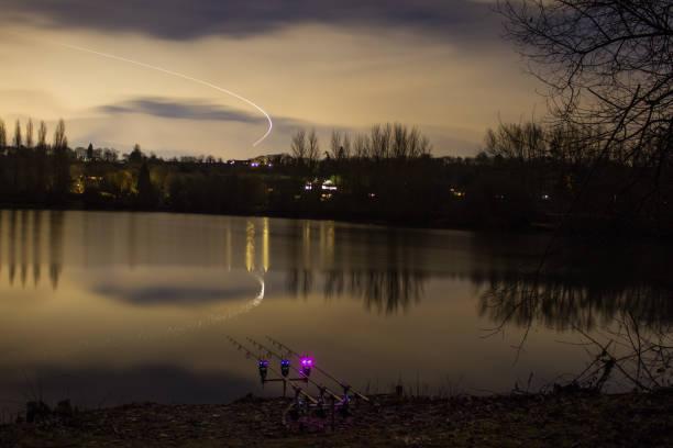 Carp Fishing Angling at Night with illuminated Alarms stock photo