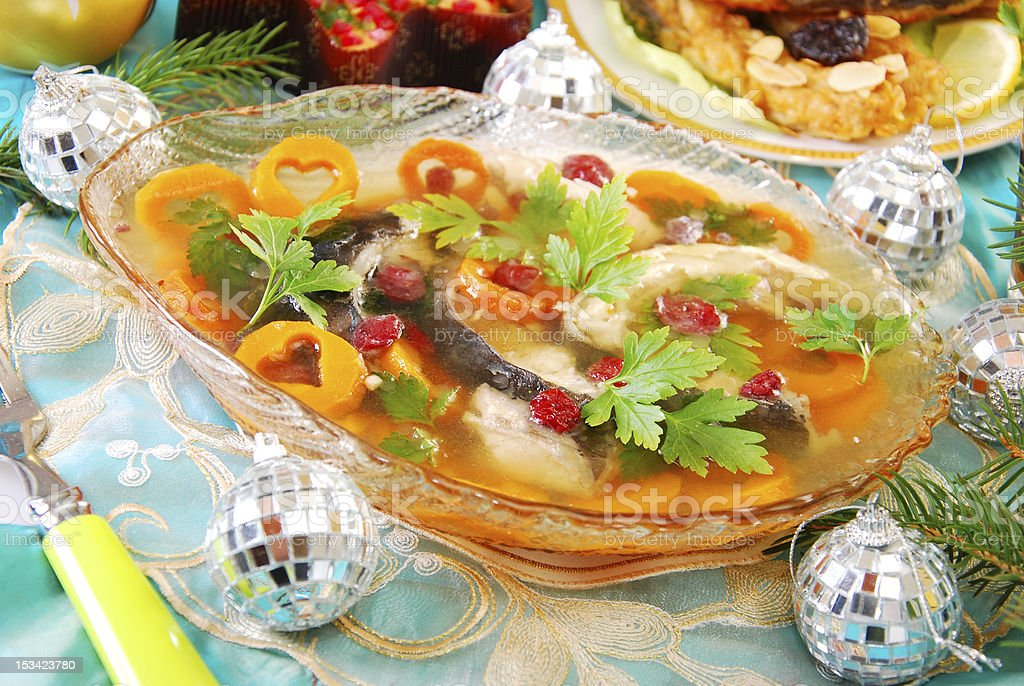 carp in jelly with carrot and cranberry for christmas royalty-free stock photo