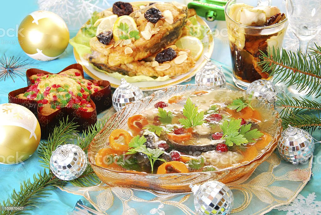carp in jelly with carrot and cranberry for christmas stock photo