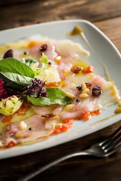 carpaccio cod salad - carpaccio salat stock-fotos und bilder