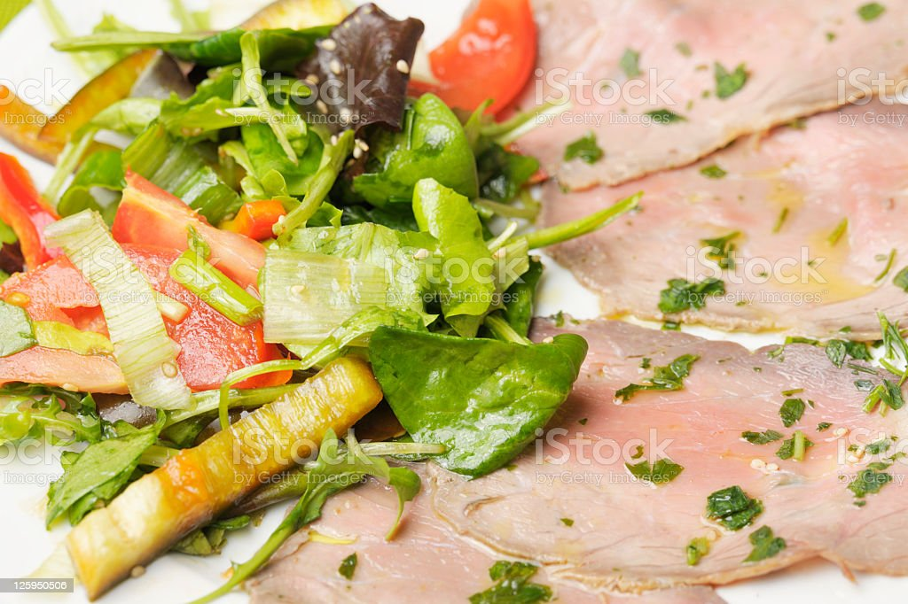 Carpaccio Cold Cuts of Buffalo Meat with Salad stock photo
