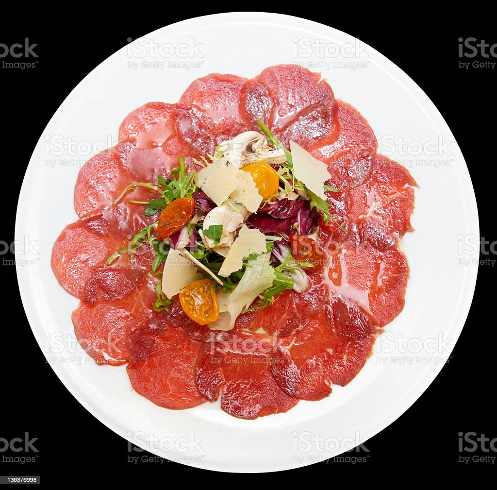 Carpaccio of beef, mushrooms, ruccola and cheese royalty-free stock photo