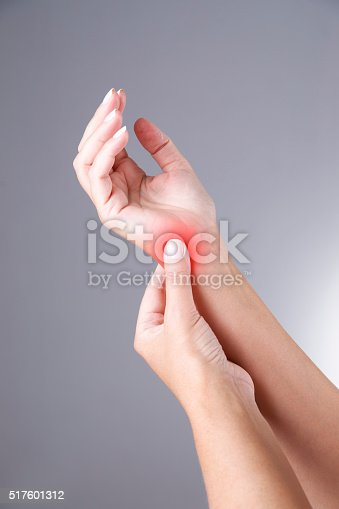668285874istockphoto Carpal tunnel syndrome on a gray background 517601312