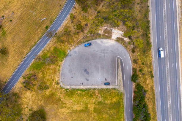 A carpark and road system running through large green farmland south of Adelaide in Australia stock photo