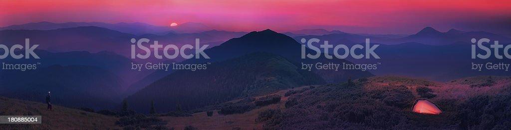Carpathian mountains, sunrise moon and stars on the background royalty-free stock photo