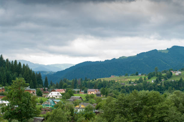 Carpathian mountains village with cloudy weather stock photo