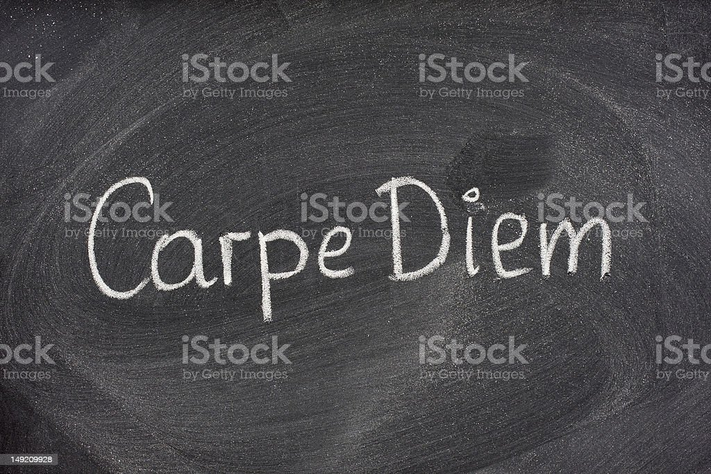 Carpe Diem phrase on blackboard stock photo