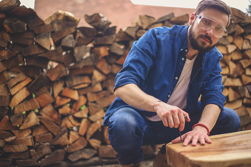 530997702 istock photo Carpenter and table 944893248