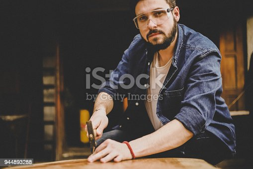 530997702istockphoto Carpenter and table 944893288