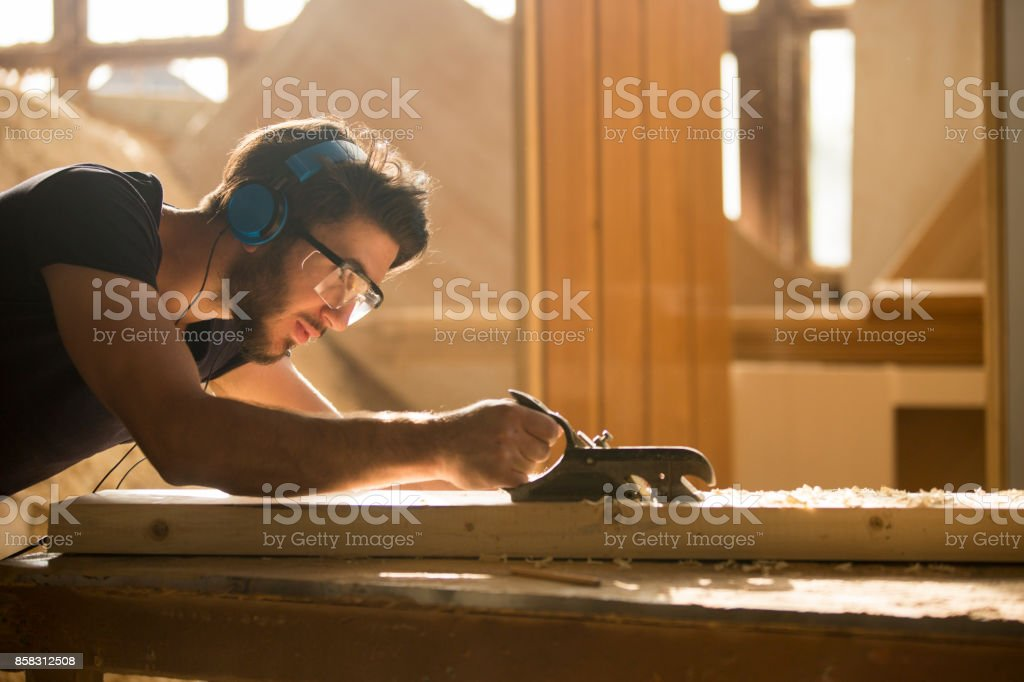 Carpenter at work stock photo