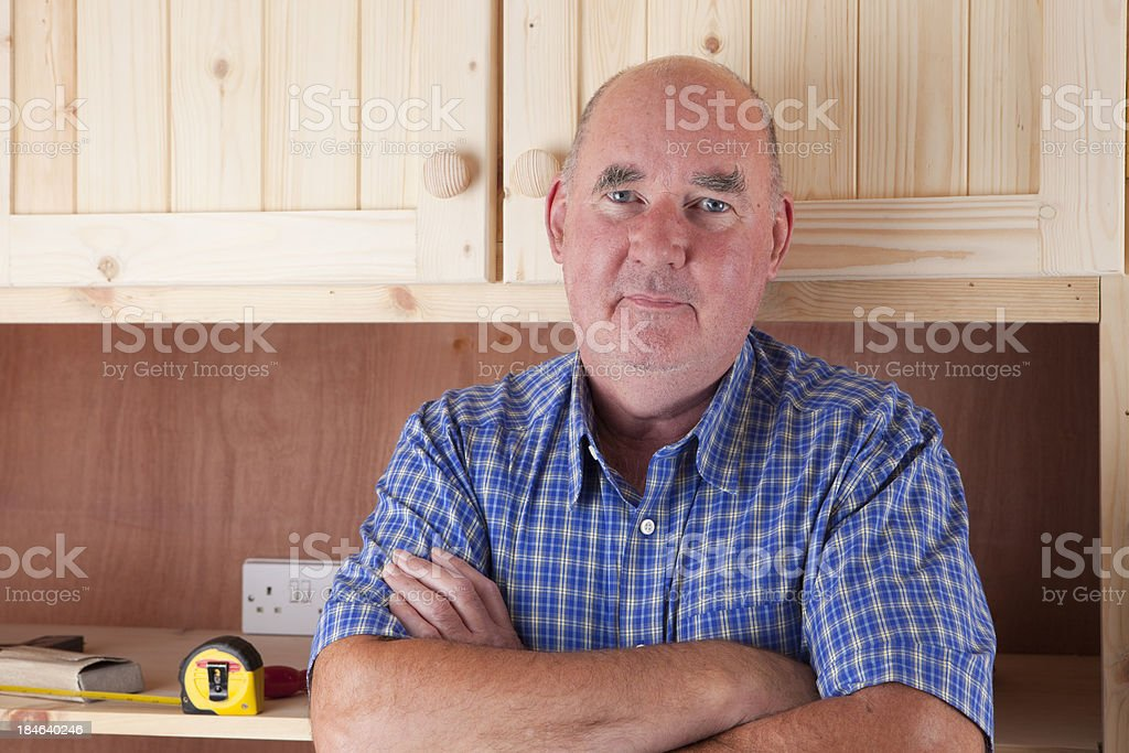 Carpenter Building Cupboards royalty-free stock photo