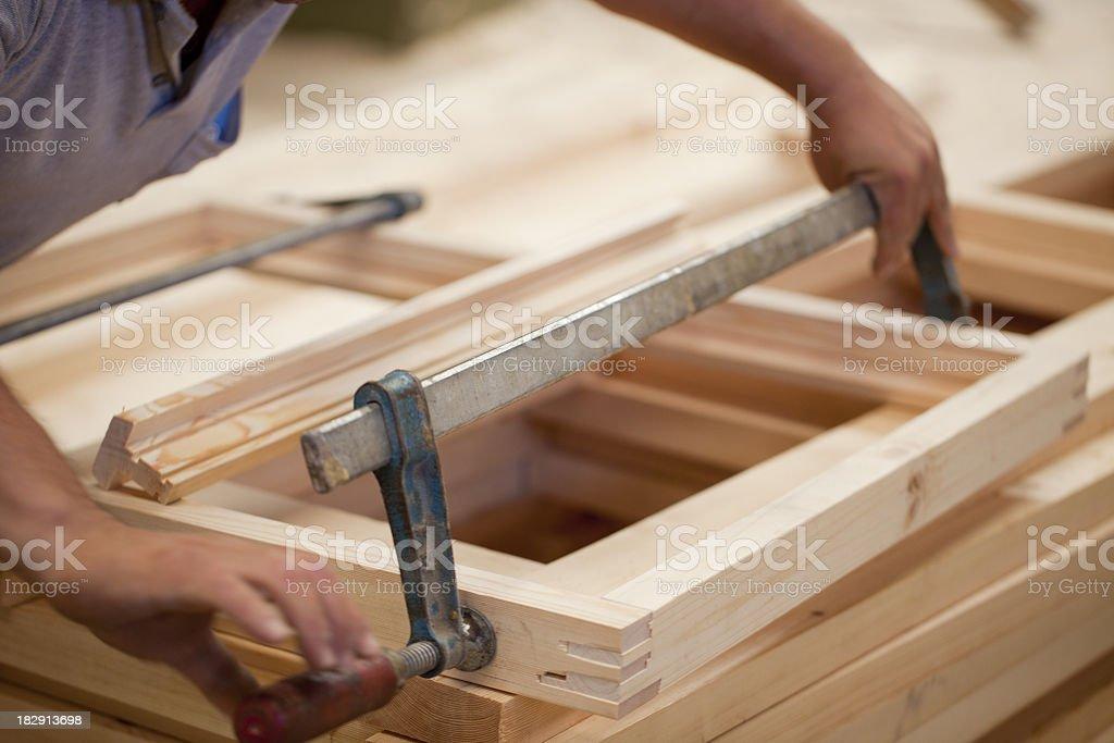 Carpenter constructing window frame stock photo