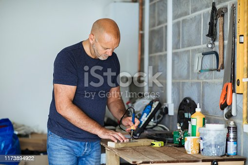istock Carpenter Crafting a Gift 1173894922