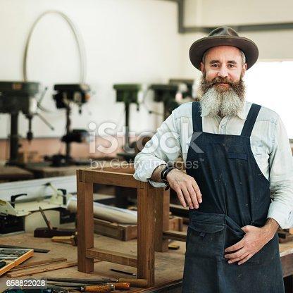 istock Carpenter Craftsman Handicraft Wooden Workshop Concept 658822028
