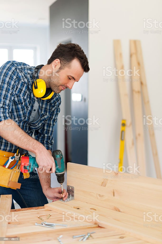 Carpenter creating new furniture stock photo
