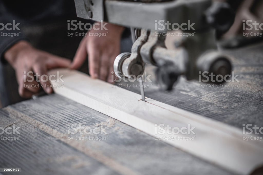 Carpenter Cutting Wooden Block For Making Chair Legs - Royalty-free Adult Stock Photo