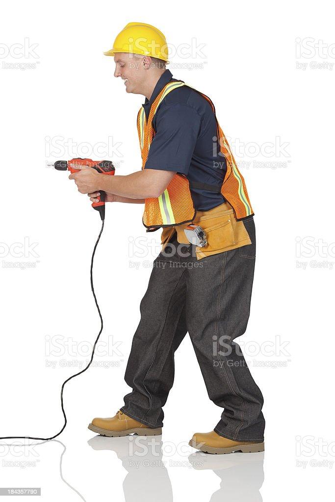 Carpenter drilling stock photo