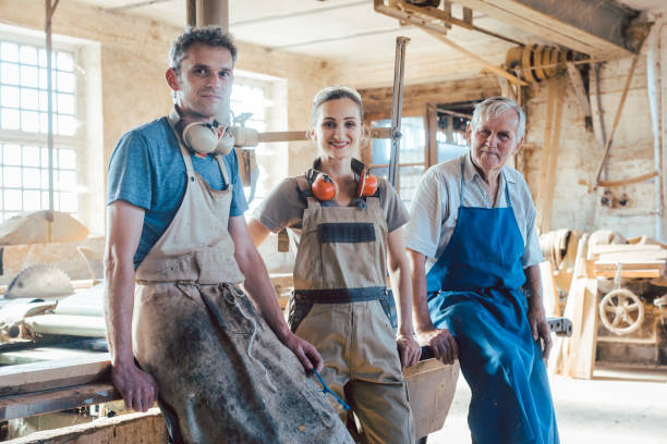 Carpenter family business with generations in the workshop stock photo