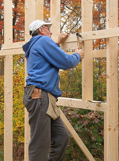 Carpenter framing exterior wall of house stock photo