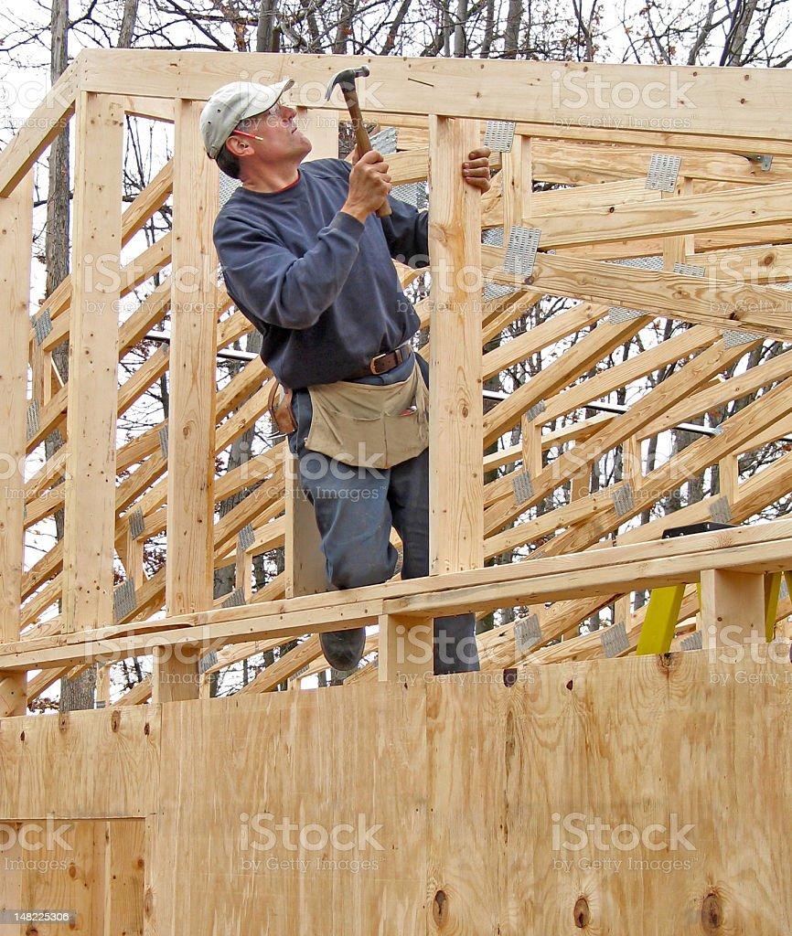 Carpenter framing gable end of house royalty-free stock photo