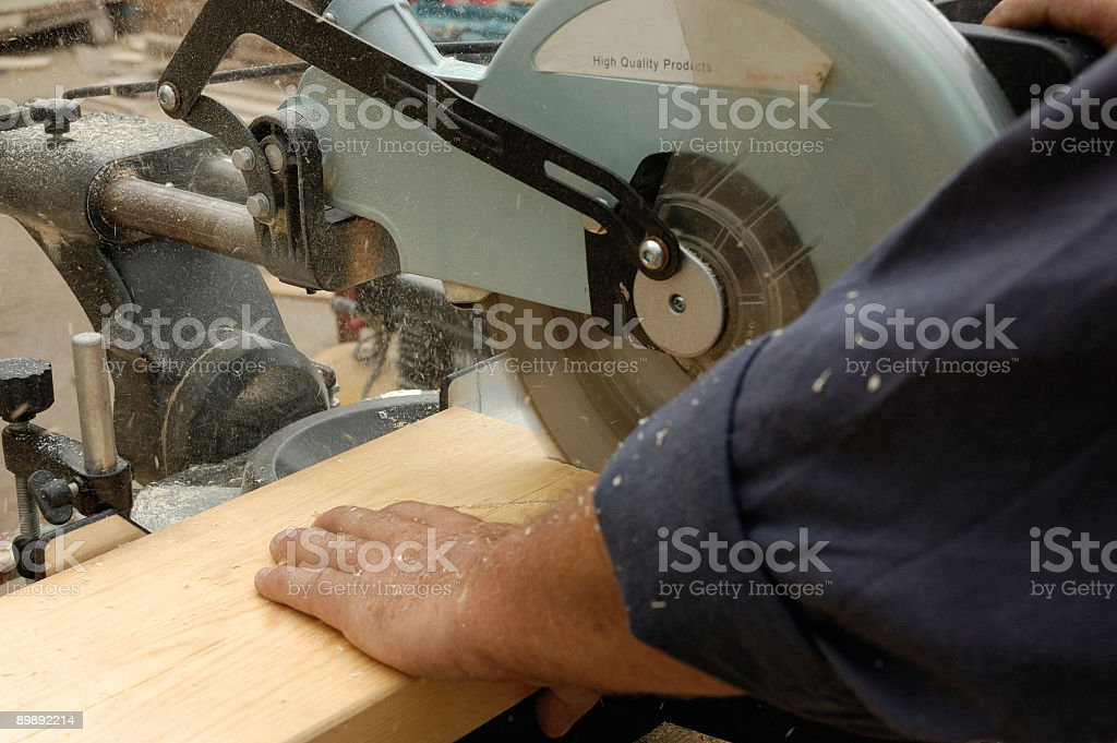 carpenter hand and  saw royalty-free stock photo