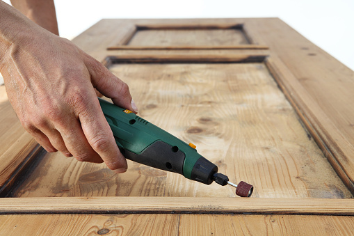 1015564946 istock photo carpenter hand work the wood with the rotary tool 1029899892