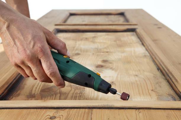 carpenter hand work the wood with the rotary tool - dremel wood stock photos and pictures