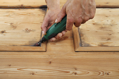 1015564946 istock photo carpenter hand work the wood with the rotary tool 1029899924
