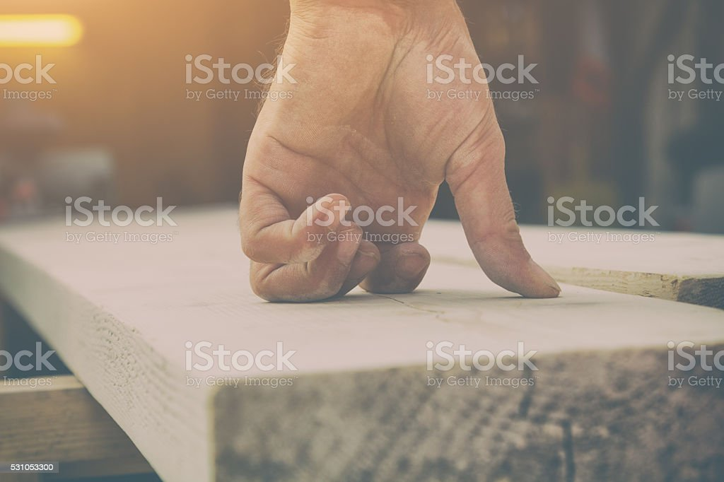 Carpenter in his small 'office' stock photo