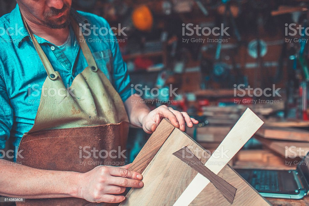 Carpenter in small workshop stock photo