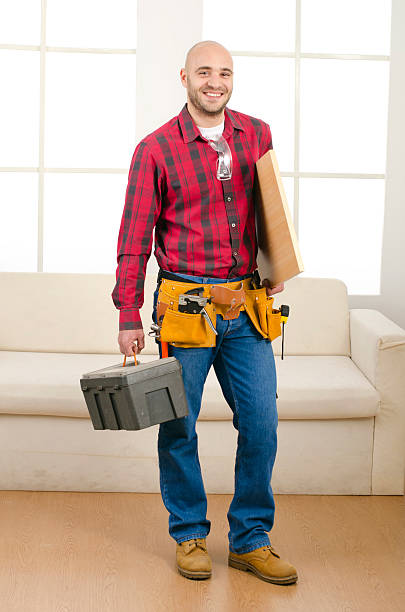 Carpenter in the house stock photo