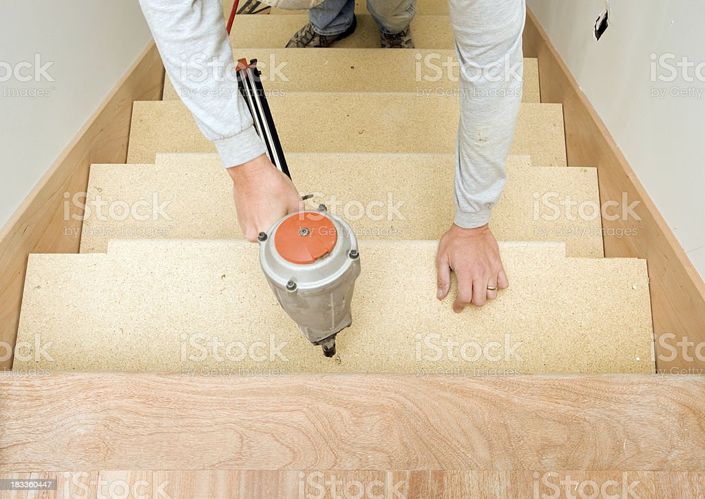 Carpenter Installing Particle Board Stair Tread Stock Photo