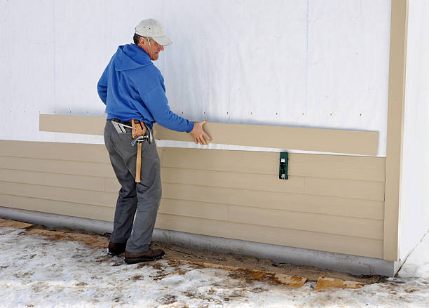 Carpenter installing siding stock photo