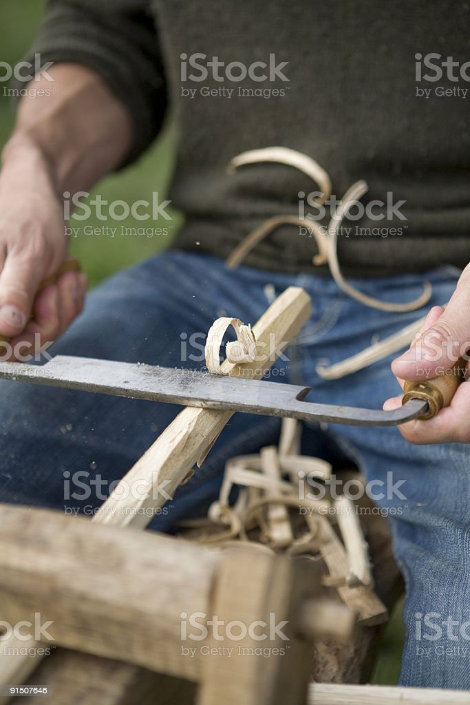 Carpenter makes traditional wooden nails stock photo
