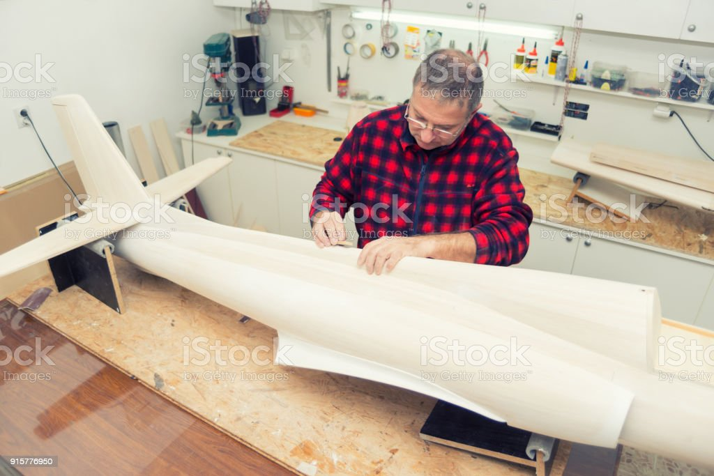Carpenter making airplane model stock photo