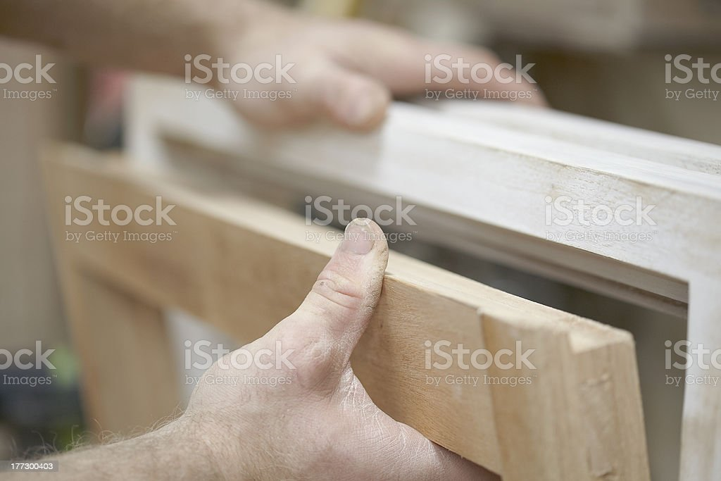 Carpenter Making Victorian Style Cupboard In Workshop royalty-free stock photo