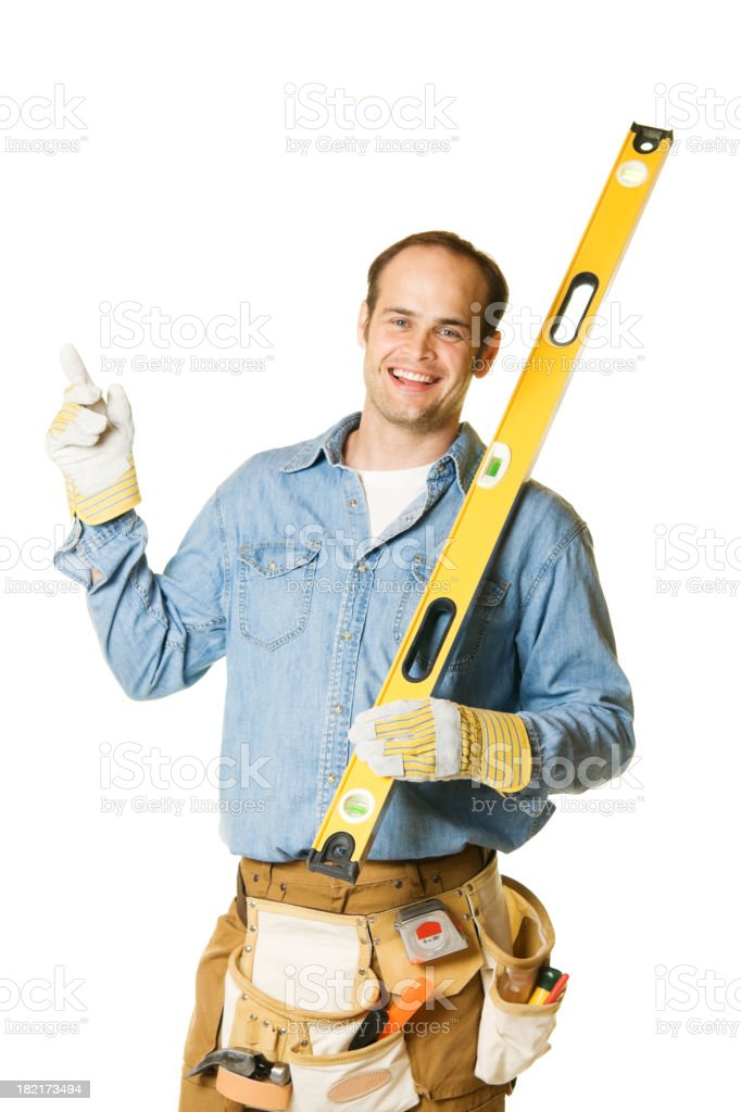 Carpenter Man Holding Level with Copy Space pointing royalty-free stock photo