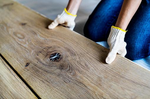 istock Carpenter man installing wooden floor 931099190
